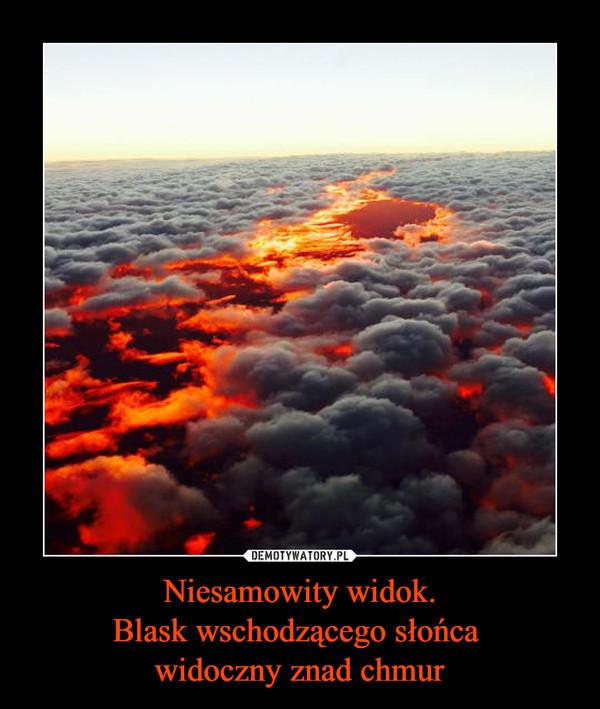 Niesamowity widok.Blask wschodzącego słońca widoczny znad chmur –